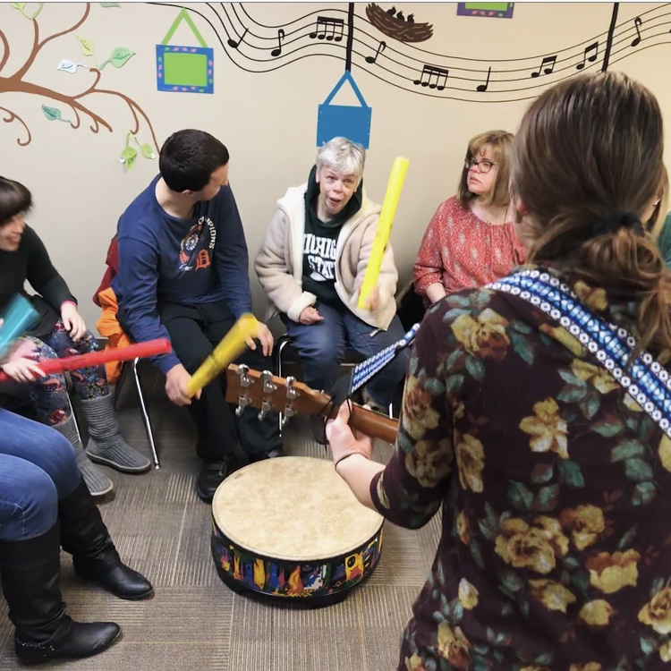 Hannah leading a music therapy session at the HGMTS Office.